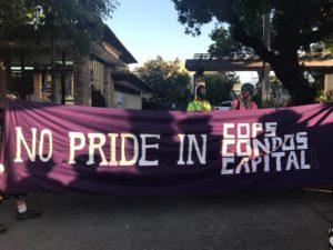 """""""no pride in cops condos and capital"""" banner"""