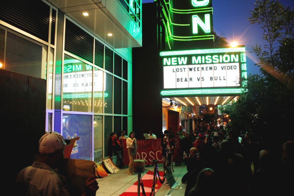 the step-and-repeat in front of the vacant ground floor retail of the vida luxury condo complex by the new new mission marquee on mission at 22nd and 21st street