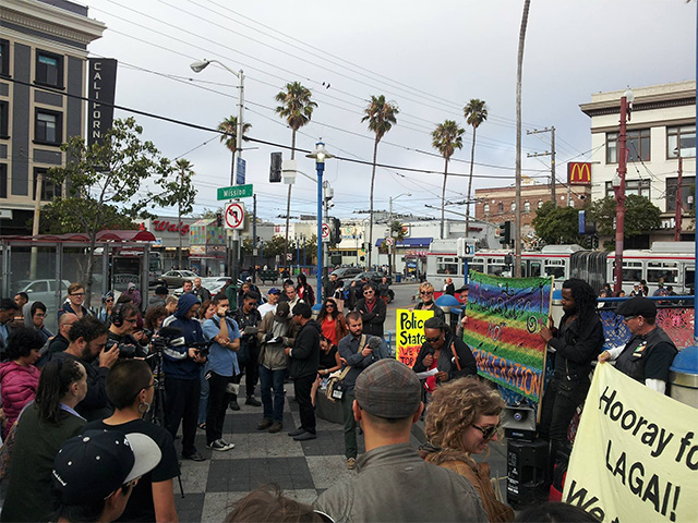 people gather for a press conference at the 16th street and mission BART