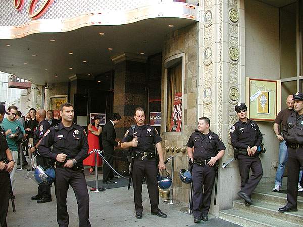 a loose line of police officers relaxing in front of ruby skye
