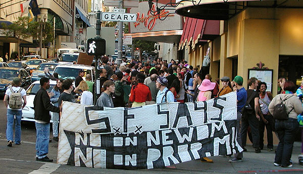 """a wider shot of people starting to gather in front of the """"s.f. says no on newsom -- no on prop m."""" banner at the corner of geary and mason near ruby skye"""