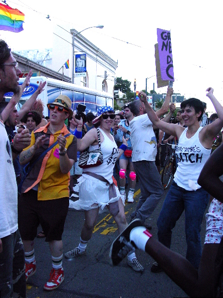 a dance party ensues at the end of the procession on castro street