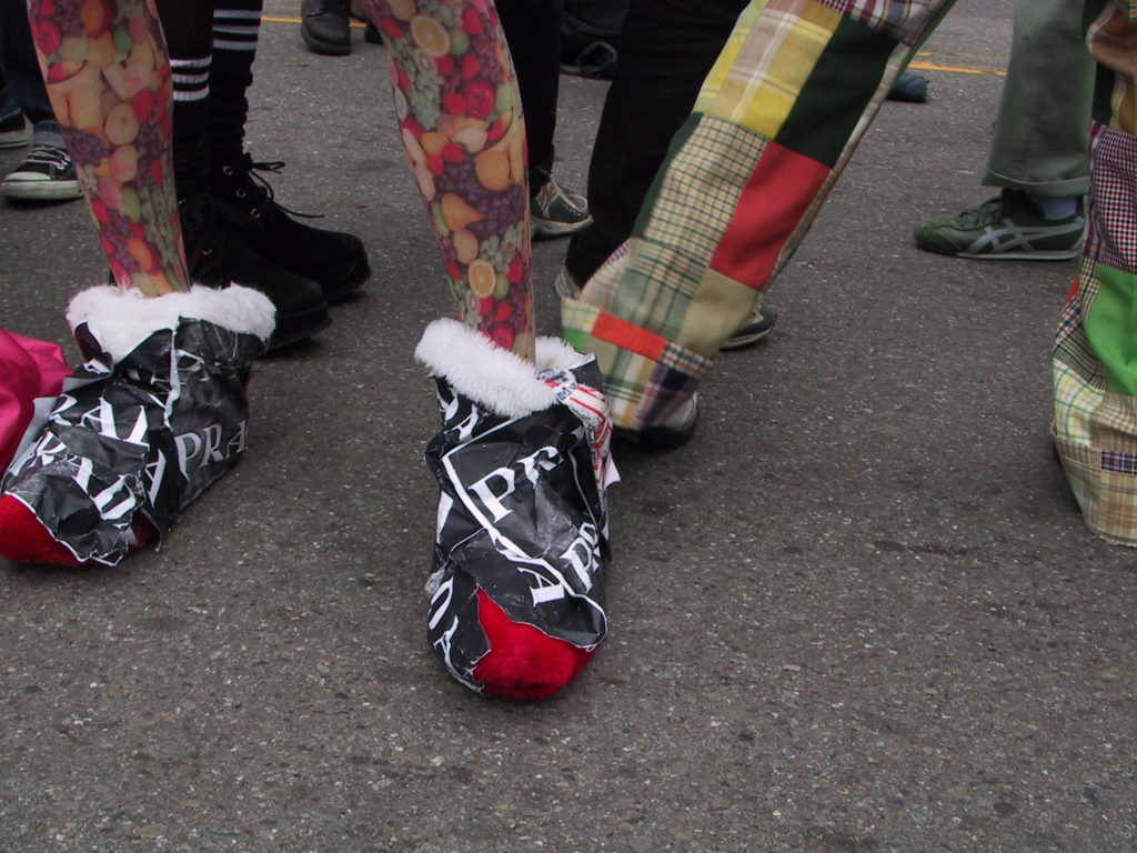 close up of footwear in the crowd filling castro street