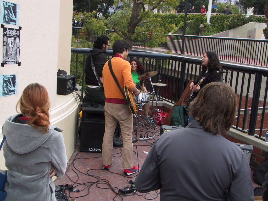 a band has started to perform in harvey milk plaza after the awards ceremony