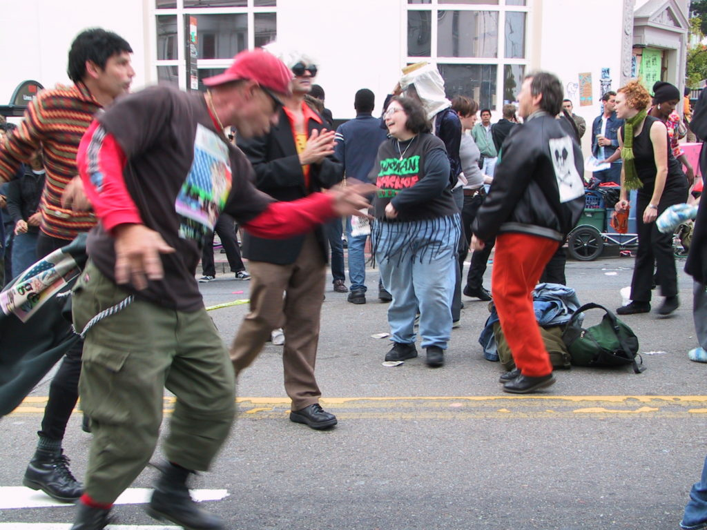 people begin to dance as the deejay starts up in the middle of castro street after the awards ceremony