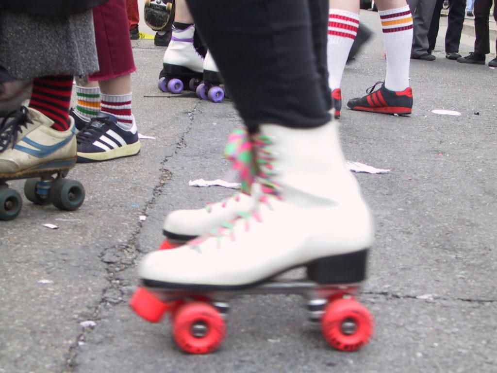 detail of rollerskaters' footwear on market street