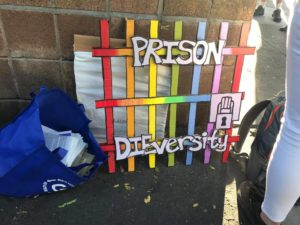 "one of the awards, rainbow jail bars that say ""prison diversity"""