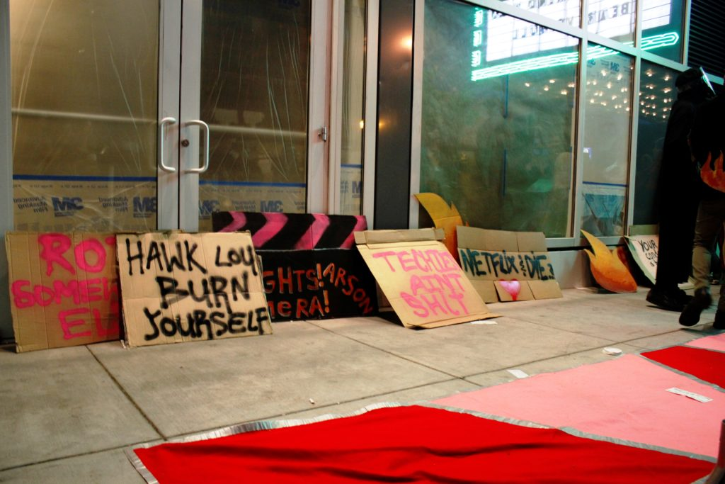 signs decorate the floor and window of the vacant ground floor retail of the vida luxury condo complex