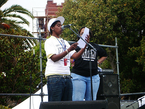 terrain dandridge reads a poem from the stage of the san francisco dyke march