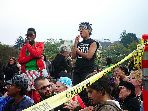 people listen to kimma and terrain onstage at the dyke march