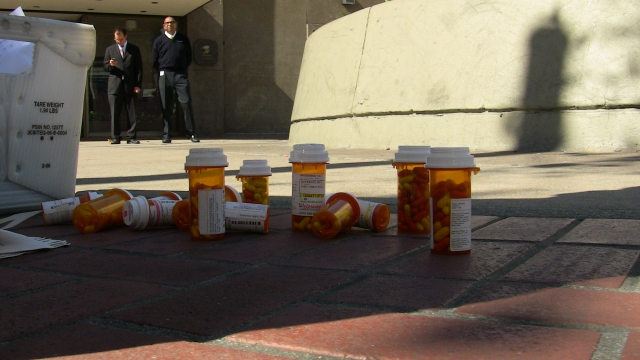 close-up of prescription bottles on the ground