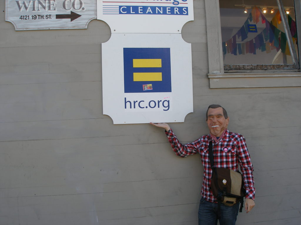 person in a president mask showing off the hrc.org sign