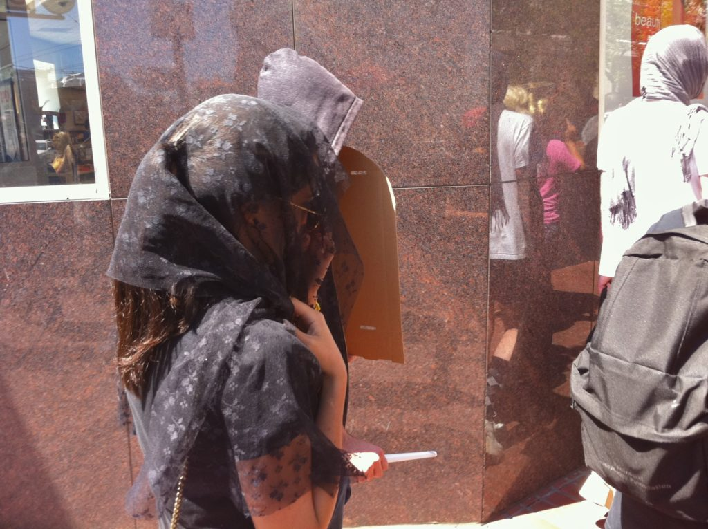 person in a veil heading up market street