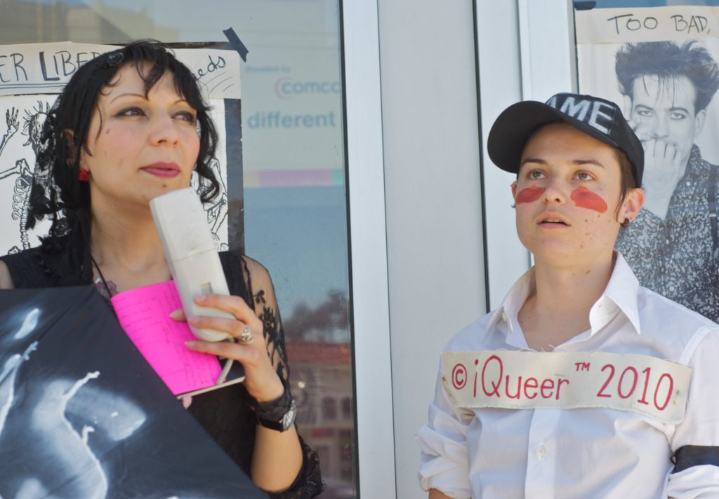 two people in front of the entrance of the lgbt center at market and octavia