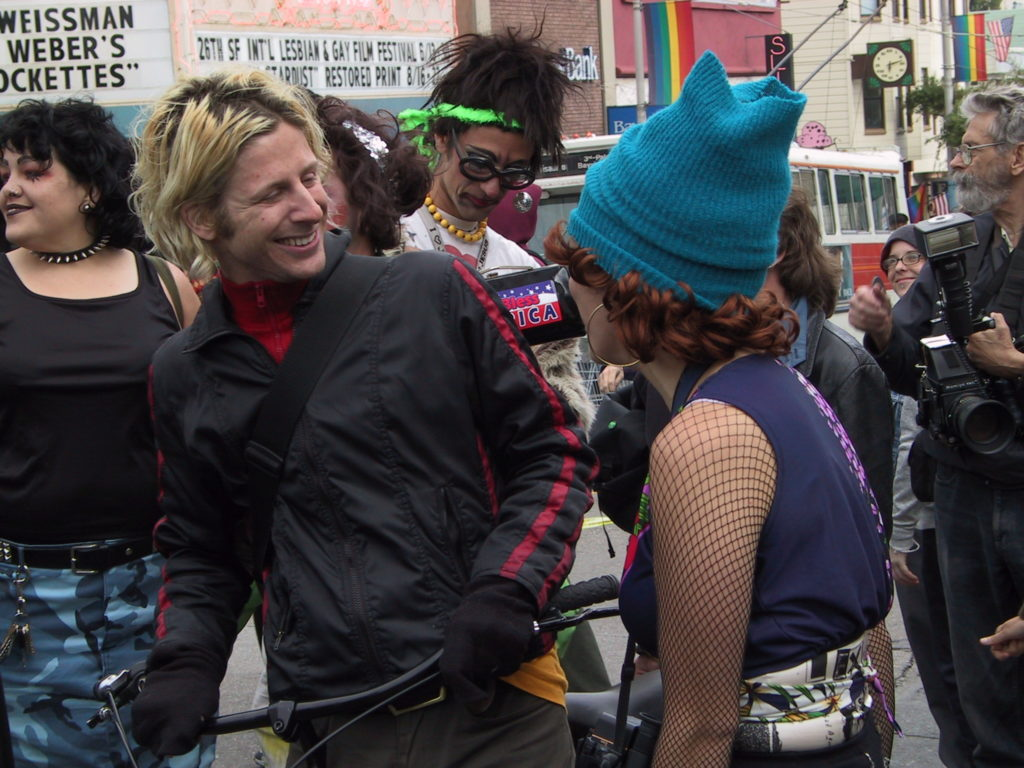 people gather in the street at market and castro after the awards ceremony