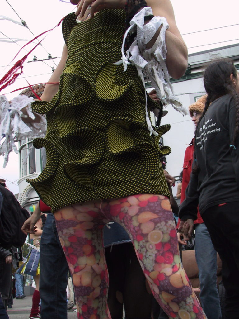 detail of someone's outfit as the crowd pushes into the middle of castro street