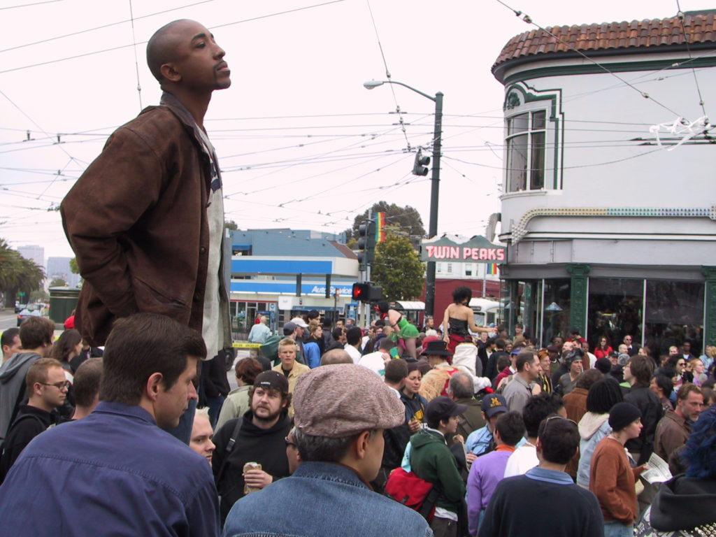 a crowd fills the street at castro and market after the awards ceremony