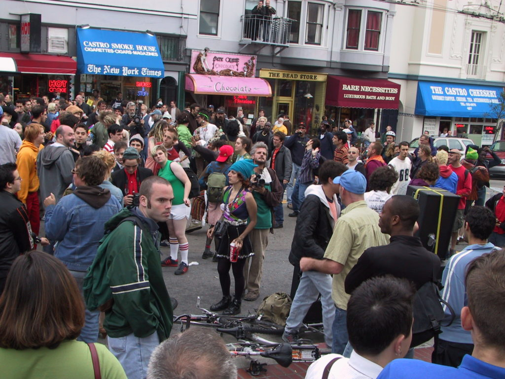a crowd fills the street at castro and market after the awards ceremony with a portable sound system visible
