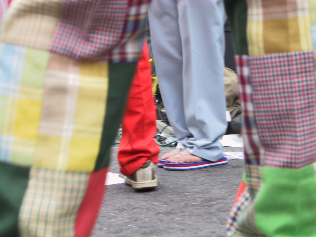 detail of revelers' footwear