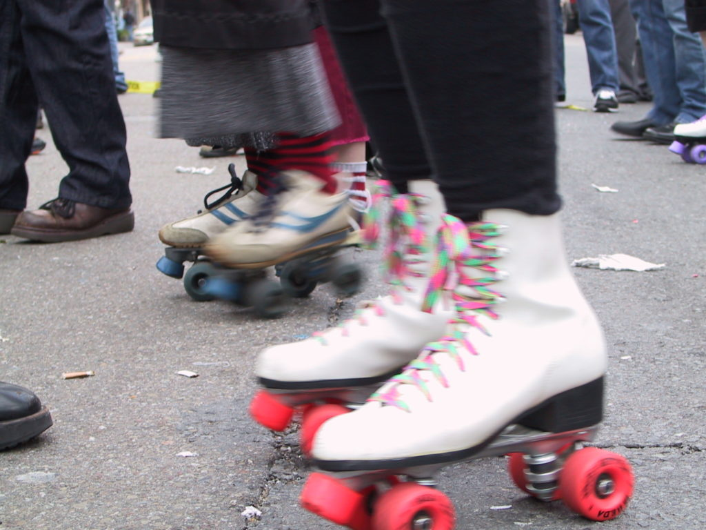 detail of rollerskaters on castro street