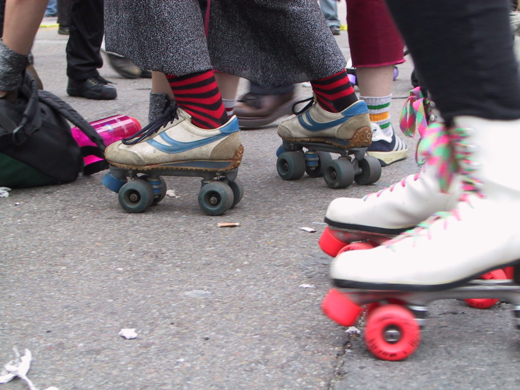 detail of rollerskaters' footwear on castro street
