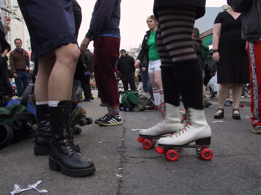detail of people's footwear on market street