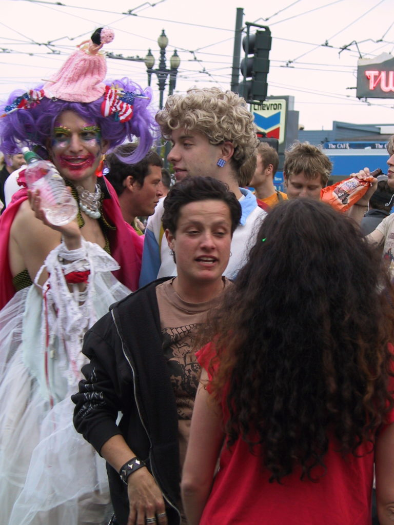 people are milling about in harvey milk plaza after the gay shame awards