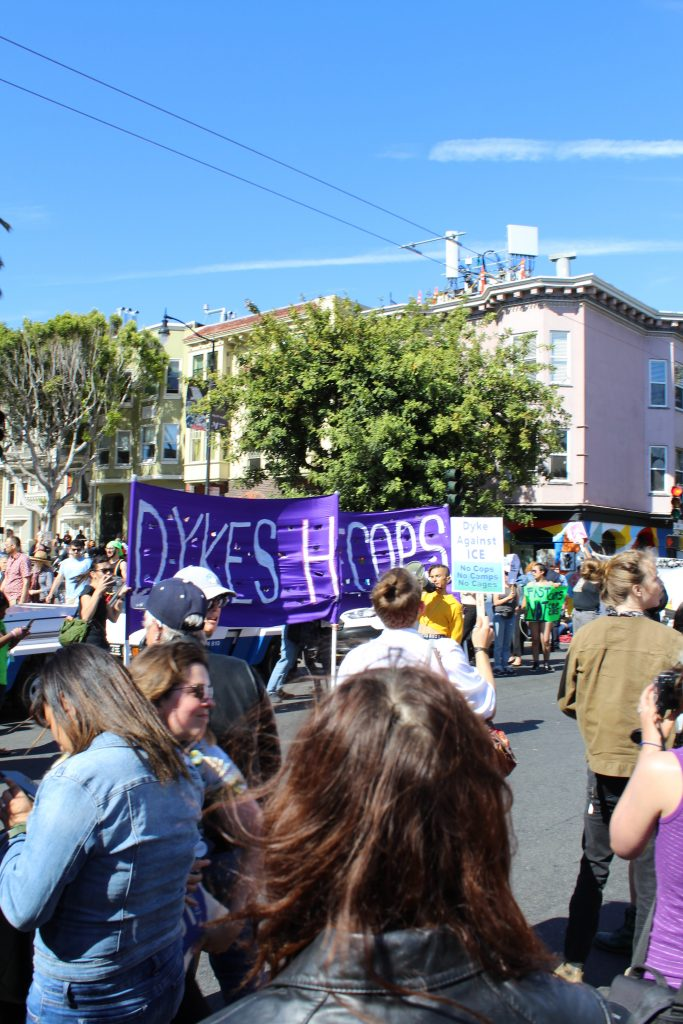 people gather at 18th and dolores with banners