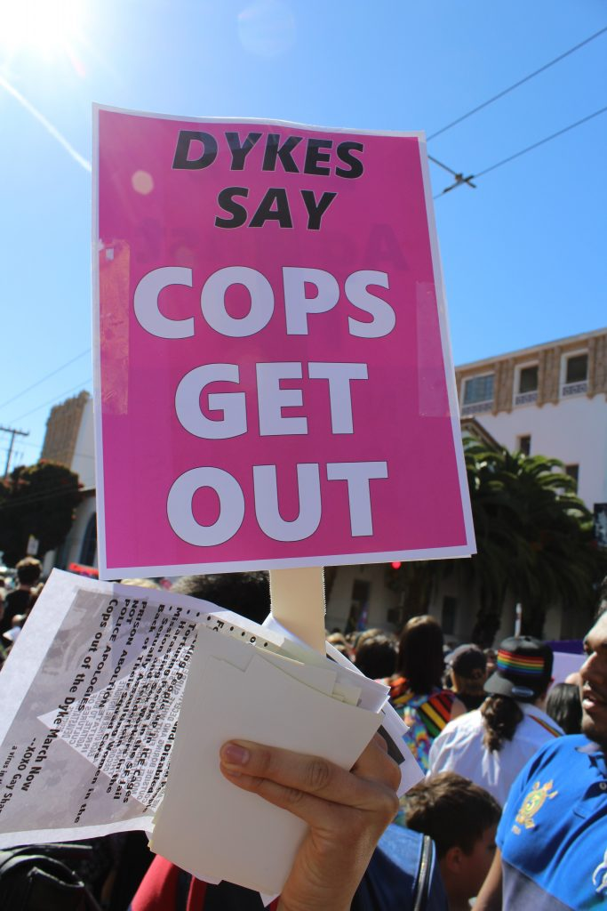 "pink sign reading ""dykes say cops get out"""